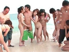 Bikini girls close by Japanese orgy on transmitted to beach
