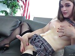 Pretty shemale Tiffany Starr slowly strokes her dick while dressed in a short unsubtle with an increment of