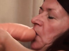 Granny loves fucking her big plaything and show it all